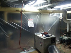 Asbestos abatement enclosure