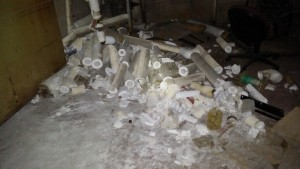 Asbestos pipe debris from copper thieves