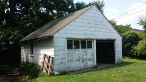 Typical asbestos transite siding on garage